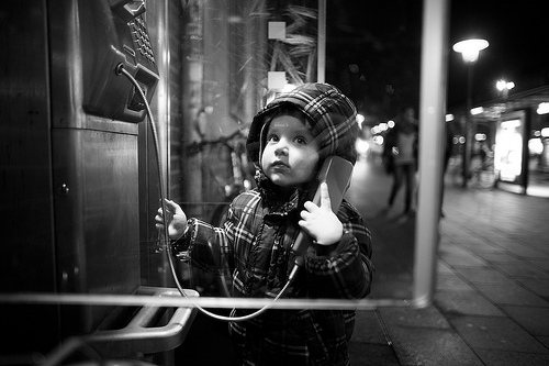 Fredrik trying out a pay-phone in Kiel, Northern Germany