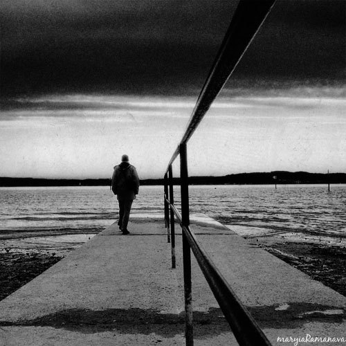 Man and Lake black and white photography