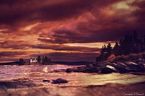 A stormy sky breaks up over Pumpkin Island on a late autumn evening, as seen from the western coast of Little Deer Isle, Maine.