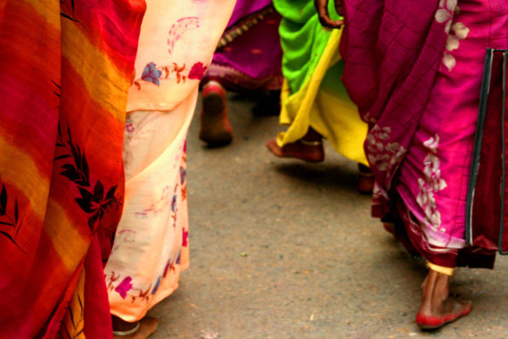 women walking in Varanasi sari