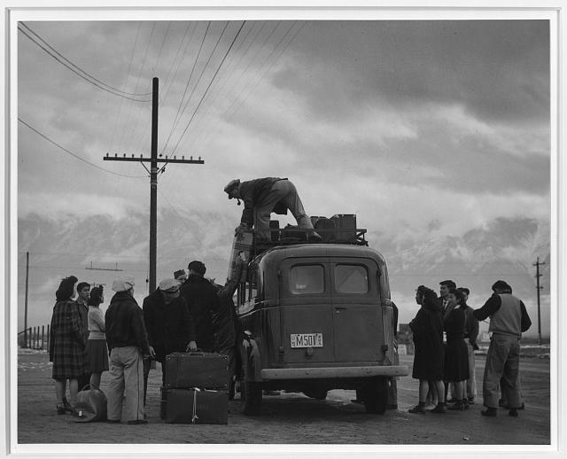 Loading bus, leaving Manzanar for relocation ansel adams