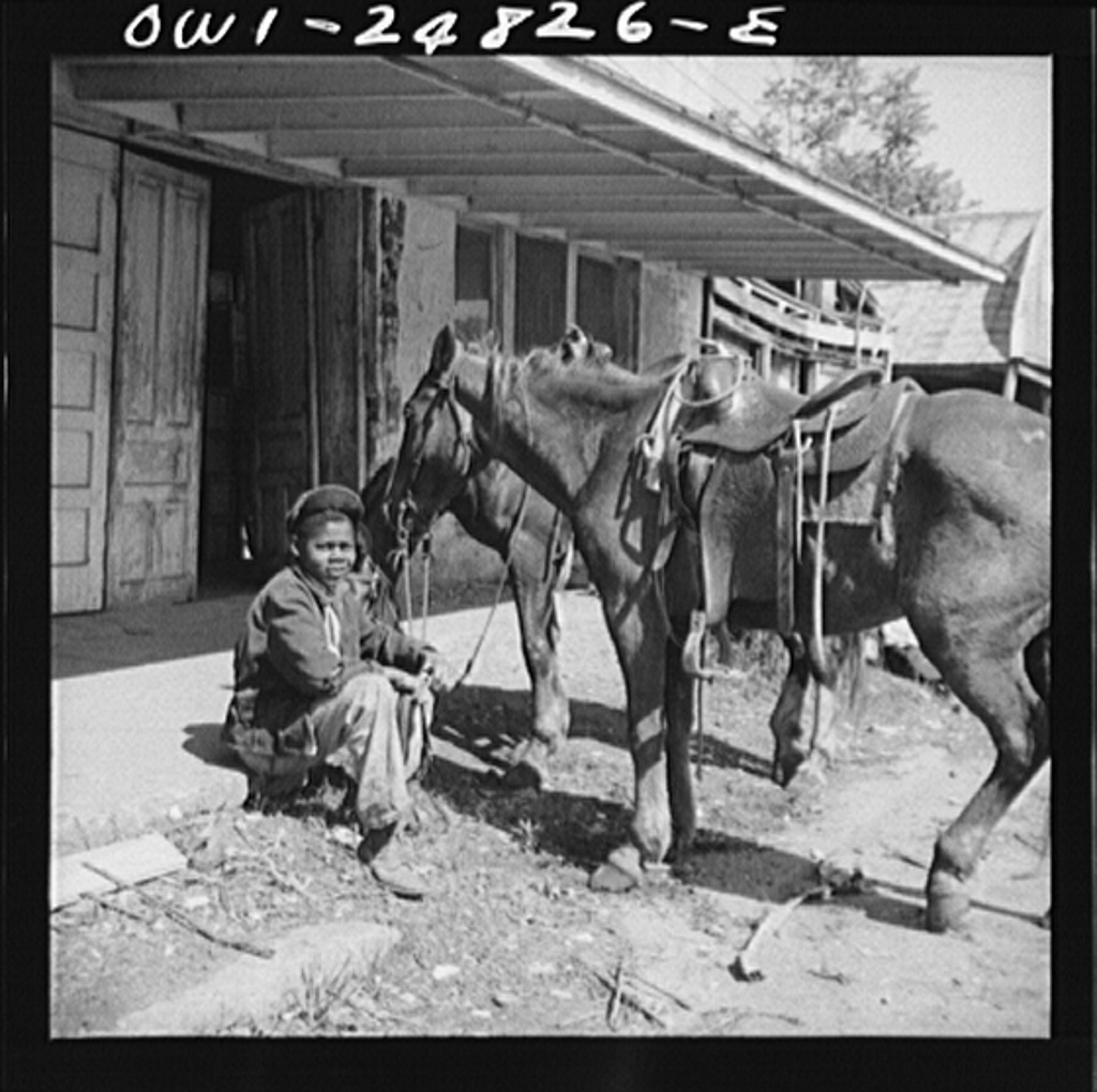 San Augustine, Texas. Colored boy holding a horse for a cattle buyer at the auction