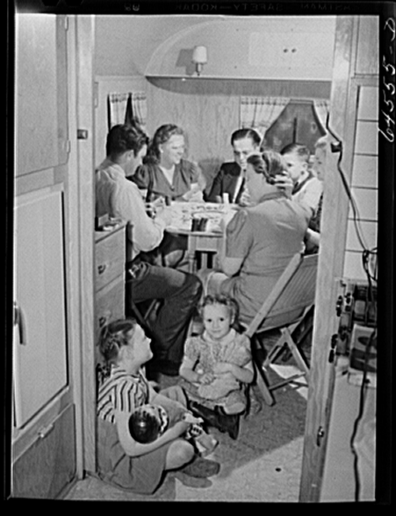 Burlington, Iowa. Sunnyside unit, FSA (Farm Security Administration) trailer camp. Sunday evening card game with neighbors in the trailer of the Heller family, who work at the Burlington ordnance plant