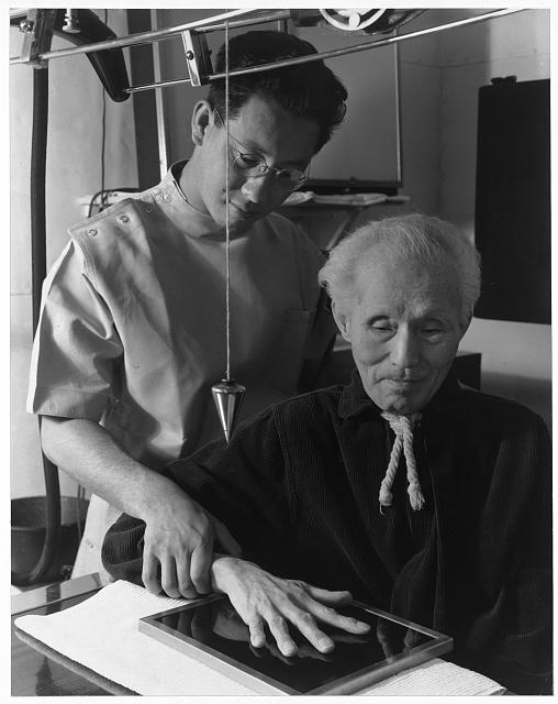 Michael Yonemetsu, [i.e., Yonemitsu] x-ray technician, and Harry Sumida in x-ray room ansel adams