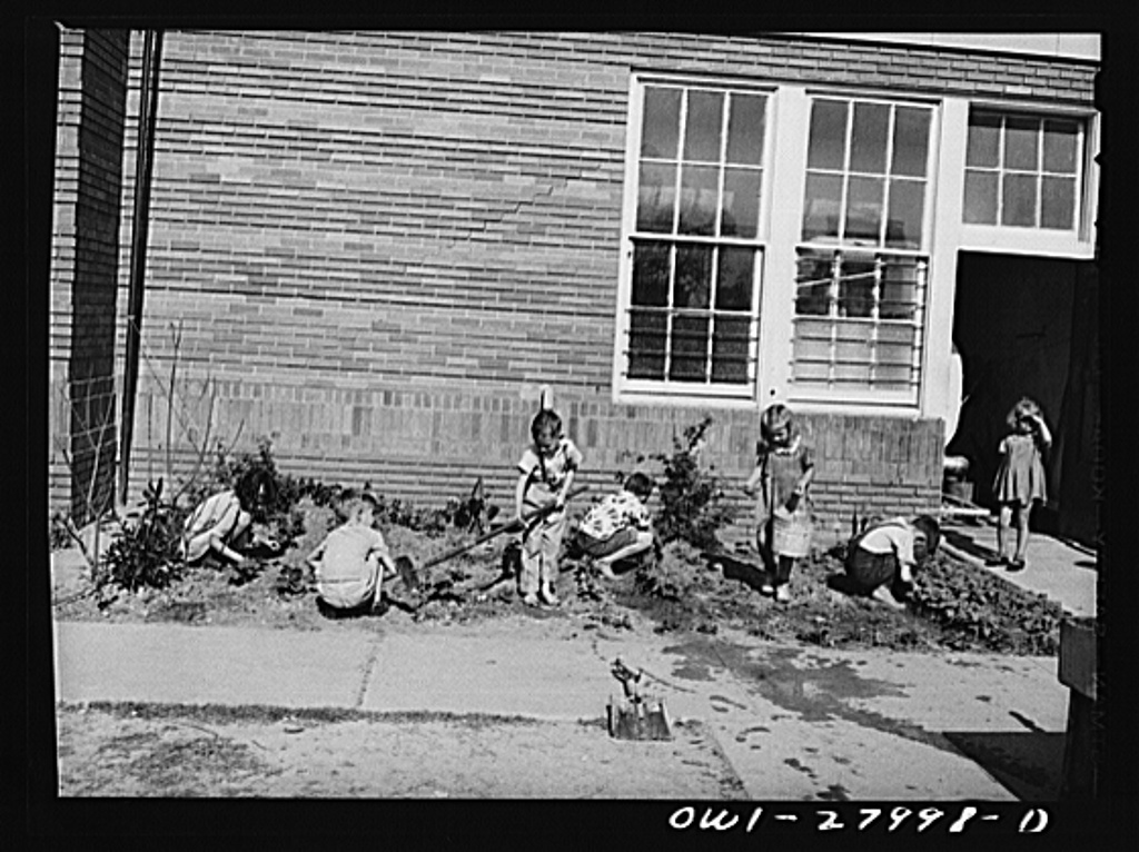 Orange, Texas. Extended school day program in the public schools. These children are working on their garden after the regular school day is over, waiting for their parents to finish work and call for them