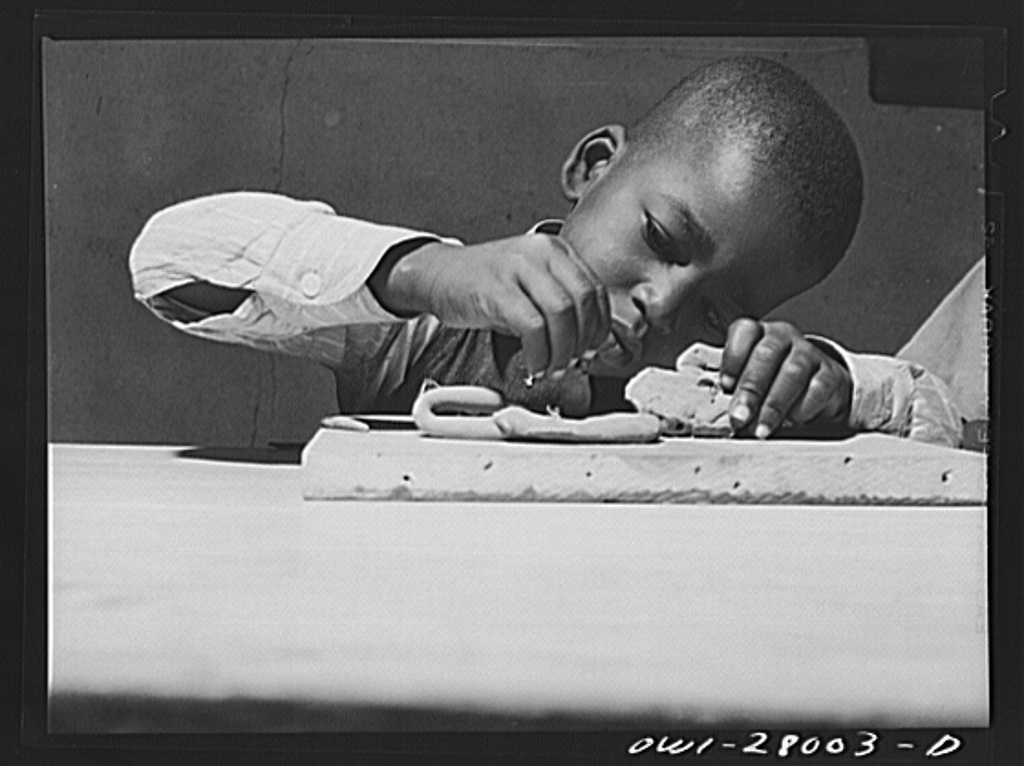Orange, Texas. Negro boys whose parents are both employed, modeling in clay at a nursery school