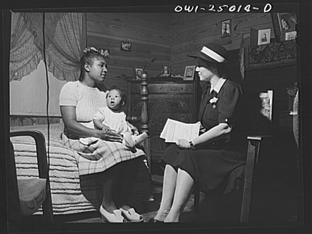 San Augustine, Texas. Amanda Gayer, the county nurse, advising a mother on child care problems