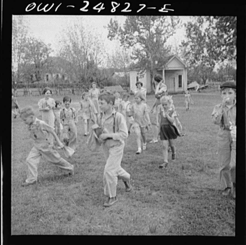 San Augustine, Texas. Children having an Easter egg hunt on the school grounds on the last day of school before Easter vacation