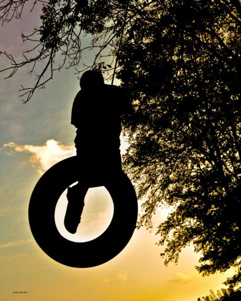 Summertime fun on the tire swing