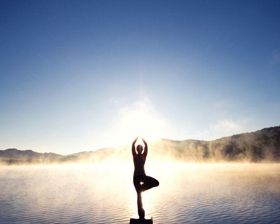 Tree Pose 'Vrksasana' on Foggy Mountain Lake at Sunrise