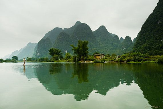 A man crosses the Li River in Yangshuo, China