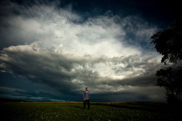 man under storm clouds