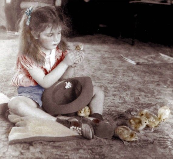 Girl with Baby Chicks on floor