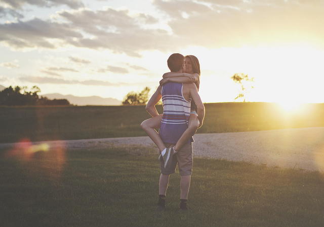 Lens Flare Couple Hugging