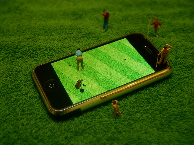 cell phone iPhone Playing REAL Miniature Golf