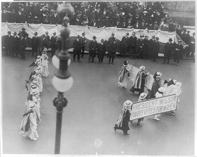 "Suffragettes parading with banner ""President Wilson favors votes for women"". N.Y.C. ca.1916"