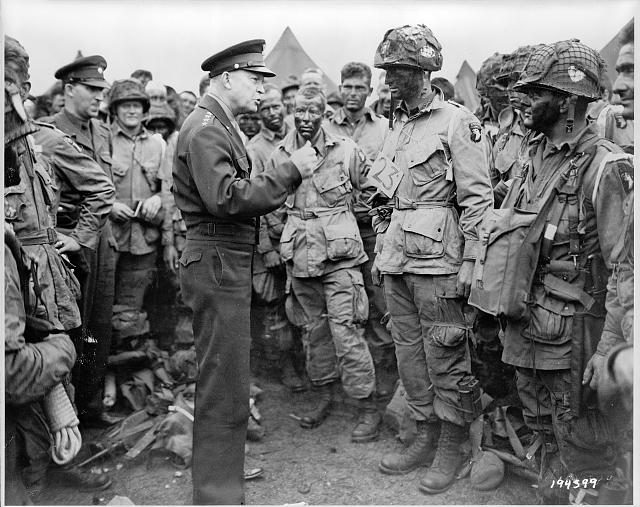 "General Dwight D. Eisenhower gives the order of the day, ""Full victory--nothing else"" to paratroopers somewhere in England, just before they board their airplanes to participate in the first assault in the invasion of the continent of Europe Library of Congress WW2 WWII"