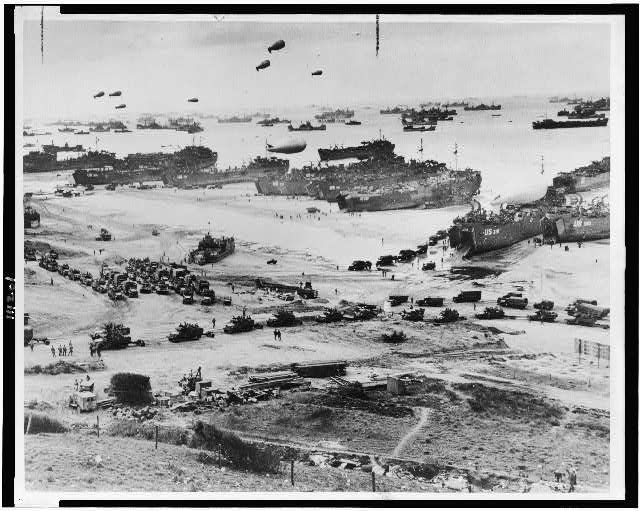 Bird's-eye view of landing craft, barrage balloons, and allied troops landing in Normandy, France on D-Day WW2 WWII Library of Congress