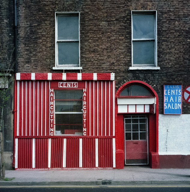 Michael Rynne's Barber shop (new premises), Ellis Quay, Dublin, 1991. A well-known character, Mr. Rynne opened this shop in 1992, a few hundred yards from his old premises, which had to be abandoned due to dereliction.